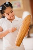 Young girl playing percussion instrument
