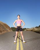 image of bare midriff  - Portrait of woman standing in the road - JPG