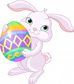 image of easter bunnies  - Illustration of happy Easter bunny carrying egg - JPG