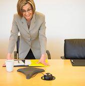 Businesswoman standing at desk