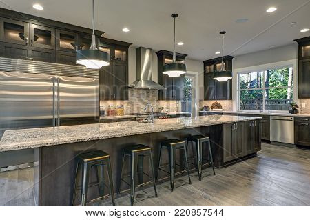 poster of Modern Kitchen With Brown Kitchen Cabinets