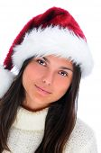 Closeup portrait of an attractive young woman wearing a Santa Claus Hat. Vertical format isolated on white.