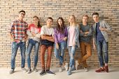 Group of cool teenagers indoors poster