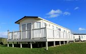 Exterior of static home on caravan site in Filey, England. poster