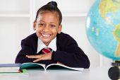 happy elementary school girl in classroom