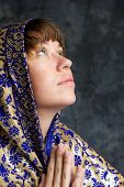 Beautiful Woman With Shawl On Head Looking Up And Praying