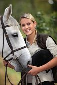 Blond teenage girl with horse