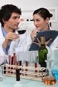 Oenologists analyzing a wine