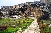 Gobustan national park ancient rocks, rock path and mountains near Baku in Azerbaijan. Exposition of poster