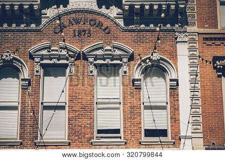 poster of Beautiful Historic Building With Old Large Windows, Outdoor Lights In A Historic Place Of Denver Cit