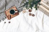 Christmas Styled Composition. Cup Of Coffee, Plaid, Old Books In Golden Basket, Pine Cones, Fir Bran poster