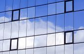 Sky And Clouds Reflected In A Modern Building Glass Facade
