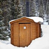 Outside toilet covered in snow in Jasper National Park, Alberta, Canada.