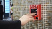 Emergency Of Fire Alarm Or Alert Or Bell Warning Equipment And Hand.in The Building For Safety. poster