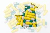 Outline Map Of Mauritania With Pills In The Background For Health And Cure