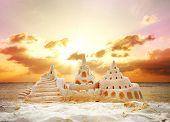 Sand Castle over Sunset on the Beach