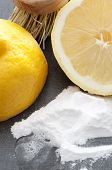 picture of baking soda  - Baking soda, lemon and a brush. Environmentally friendly cleaning ingredients. - JPG