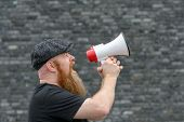Man Yelling Into A Megaphone At A Rally poster
