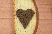Piece Of A White Loaf With The Cut Out Heart From Brown Bread