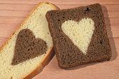 Pieces Of Brown And White Bread With The Hearts Cut Out From Bread
