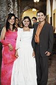 stock photo of quinceanera  - Family in eveningwear smiling for the camera - JPG