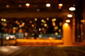 Top Of Wood Table With Bokeh Of Glor Blur Lamp Light In Party Bar Or Pub In The Christmas Dark Night poster