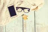 Warm White Knitted Plaid, Coffee, Phone, Glasses, Autumn Leaves On A Wooden Background. poster