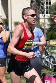 Jason Hartmann (Colorado) races up Heartbreak Hill during the Boston Marathon