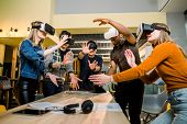 Young Multiracial Business People Wearing Virtual Reality Goggles With Touching Air During Vr Meetin poster