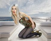 image of concubine  - Young attractive blonde woman in shining dress on deck of yacht - JPG