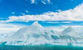 Global warming - Greenland Iceberg landscape of Ilulissat icefjord with giant icebergs. Icebergs fro poster