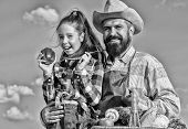 Only Organic And Fresh Harvest. Man Bearded Rustic Farmer With Kid. Farmer Family Homegrown Harvest. poster