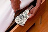 many dollar bills are hidden under the bed