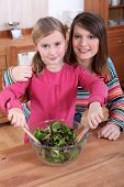 Mother and daughter making a salad together