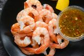 Fresh Shrimps Served On Plate With Seafood Sauce / Boiled Peeled Shrimp Prawns Cooked In The Restaur poster