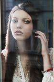 foto of have sweet dreams  - Portrait of a lovely young lady looking through glass window  - JPG