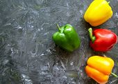 Fresh Organic Ripe Bell Peppers Or Capsicum On Grey Table, Top View. Fresh Vegetables Bell Red, Yell poster