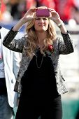 PASADENA, CA. - JAN 1: ESPN reporter Erin Andrews takes pictures with her Iphone during the 2011 Ros
