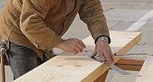 Carpenter Marking Out Steps On A Stringer