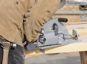 Carpenter Cutting Steps Into A 4X12