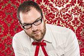 Bearded Man Wearing Black Glasses, White Shirt, Texas Tie