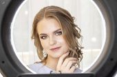 Ring Lamp. Photographing A Model In A Beauty Salon After Applying Makeup And Hairstyles. In The Eyes poster