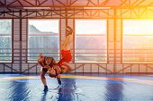 Greco-roman Wrestling Training, Grappling. Two Greco-roman  Wrestlers In Red And Blue Uniform Making poster