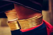 Womans Legs In Traditional Bracelets Long Neck Wearing At Traditional Costume. Tribal Village Thaila poster