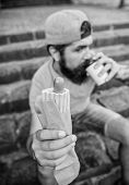 Man Bearded Bite Tasty Sausage And Drink Paper Cup. Street Food So Good. Urban Lifestyle Nutrition.  poster