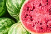 Lots Of Big Sweet Watermelons And One Cut Watermelon In Half. A Close-up Of A Ripe Juicy Watermelon  poster
