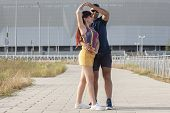 Young Couple Dancing Latino Dance Against Urban Landscape. poster