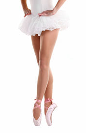 foto of ballet dancer  - Lower half waist down image of ballerina dancing on pointe - JPG