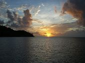 Caribbean Sunset With Clouds, Blue Orange Sky, And The Ocean poster