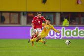 VIENNA,  AUSTRIA - OCTOBER 16:  Azat Nurgaliyev (#13 Kazakhstan) fouls Martin Harnik (#11 Austria) f